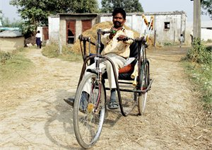 A hand-powered tricycle for a disabled person