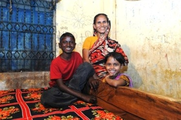 A boy cured from leprosy with his family